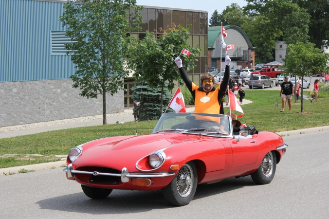 Museum Man waves to the crowd at the Canada Day parade.